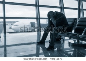 stock-photo-sad-man-waiting-for-delayed-flight-in-airport-497143678
